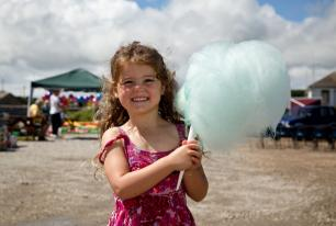 Kensa holds up her huge blue candy floss at Hayle Celebration Day 2016